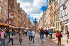 People on the Long Lane of the old town in Gdansk, Poland. Stock Photo