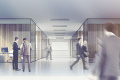 People in a long office corridor with a poster Royalty Free Stock Image