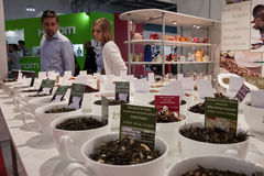 People look at cups of tea at Macef home show in Milan Stock Images