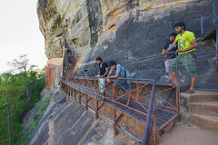 People look down from the passage to Sigiriya rock fortress in Sigiriya, Sri Lanka. Royalty Free Stock Image