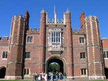 People look at Entrance to Hampton Court Palace Royalty Free Stock Image