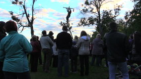 People look at man successfully climb on high log pole get prize stock footage