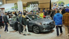 Toronto, Canada, February 20, 2018: People look at the new model of the car Subaru Legacy. At the big international. People look at the new model of the car stock video