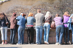 People look at  rock wall in zoo Stock Photography