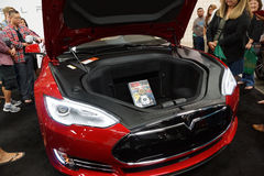 People look at The Tesla Model S on display on display at the Mo Stock Image