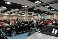 People look at Vehicles on display on display at the Motor Show Stock Images
