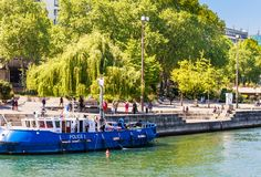 People look at work of French water policemen in a boat Royalty Free Stock Photo