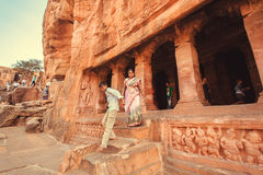 People looking ancient caves with the 6th century Hindu temple and carved columns Royalty Free Stock Images