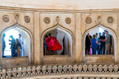 People looking through arches at charminar hyderabad Royalty Free Stock Photo