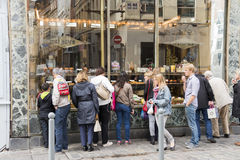 People looking at a bakery Royalty Free Stock Images