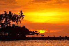 People are looking beautiful sunset on tropical beach of Senggigi island Lombok, Indonesia. royalty free stock photos
