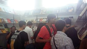 People looking at books at a book feria. At college. bookstore Royalty Free Stock Photos