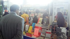 People looking at books at a book feria. At college. bookstore Stock Photos