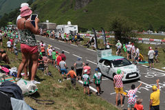 People looking at the caravan of the Tour de France Stock Photo
