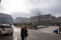 People looking at carillon at Mont des Arts. Tourists and locals looking at the bells at Mont des Arts as they strike twelve o`clock in Brussels, Belgium, on Stock Photos