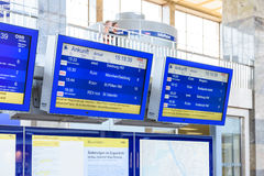 People Looking At Departure And Arrivals Screens Stock Image