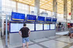 People Looking At Departure And Arrivals Screens Royalty Free Stock Images