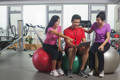 People looking at digital tablet in the gym Royalty Free Stock Photo