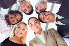 People looking down. Group of business people in a circle looking down Royalty Free Stock Photography