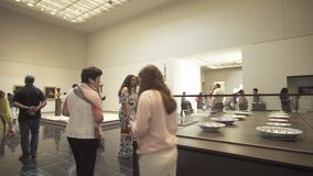People looking at exhibits in the new Louvre Museum in Abu Dhabi stock footage video. Abu Dhabi, UAE - April 04, 2018: People looking at exhibits in the new stock video footage