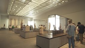 People looking at exhibits in the new Louvre Museum in Abu Dhabi stock footage video. Abu Dhabi, UAE - April 04, 2018: People looking at exhibits in the new stock video