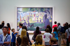People looking at a famous painting