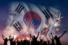 People are looking on fireworks and flag of South Korea. Happy people are looking holiday fireworks with flag of South Korea in sky, independence day royalty free stock images