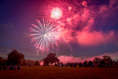People looking at fireworks in honor of Independence Day Royalty Free Stock Images