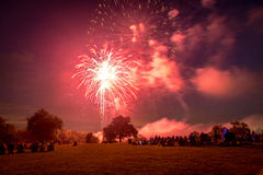 People looking at fireworks in honor of Independence Day Royalty Free Stock Image