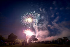 People looking at fireworks in honor of Independence Day Stock Photography