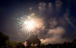 People looking at fireworks in honor of Independence Day Royalty Free Stock Photo
