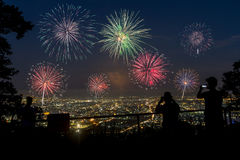 People looking at fireworks Stock Photos