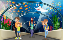 People looking at fish in the aquarium. Illustration Royalty Free Stock Photo