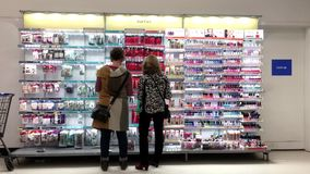 People looking health and beauty products stock video footage