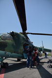 People looking into the helicopter. In the airport of Erebuni, Armenia, 11.06.2014 Royalty Free Stock Photos