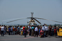 People looking at the helocopter. People looking at the helicopter in the airport of Erebuni, Armenia, 11.06.2014 Stock Images