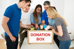People looking inside donation box Stock Photography