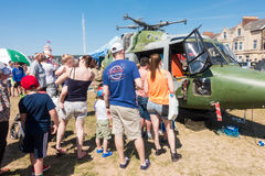 People looking inside a helicopter. Weston-super-Mare, United Kingdom -  June 17, 2017: People are queuing  to have a look inside the helicopter at the public Royalty Free Stock Image