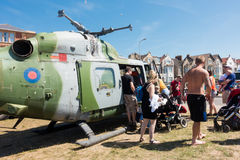 People looking inside a helicopter. Weston-super-Mare, United Kingdom -  June 17, 2017: People are queuing  to have a look inside the helicopter at the public Stock Photos
