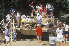 People Looking at Military Tank Stock Image