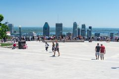 People looking at Montreal Skyline from Mont Royal lookout stock photos