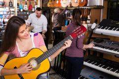 People looking at musical instruments Stock Image