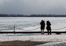 People Looking out at Lake Ontario in the Winter Royalty Free Stock Photography