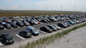 People looking for parking at the beach stock footage