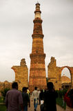 People looking at the Qutub minar delhi Royalty Free Stock Photo