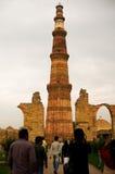 People looking at the Qutub minar delhi Royalty Free Stock Photo