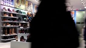 People looking shoes at shoe store stock footage