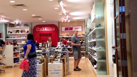 People looking a shoes at shoe store stock video