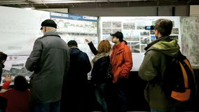 People looking at subway plans from the 5th Bucharest line stock video footage
