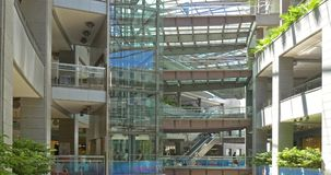 People Looking For Summer Sales In Shopping Luxury Mall Interior stock video